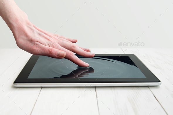 human hand touching futuristic screen - Stock Photo - Images
