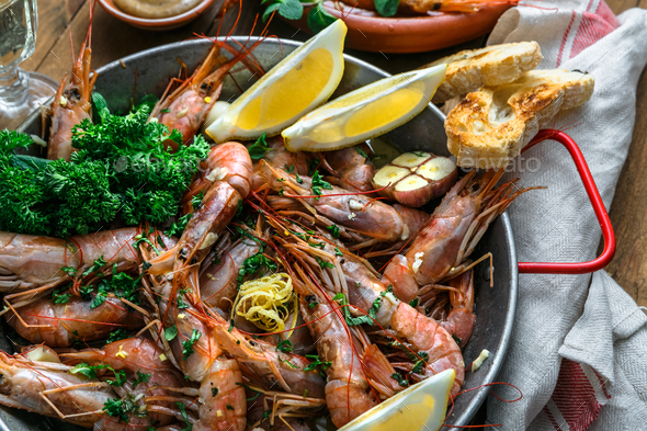 Close view of tiger prawn shrimps roasted with lemon garlic and wine - Stock Photo - Images