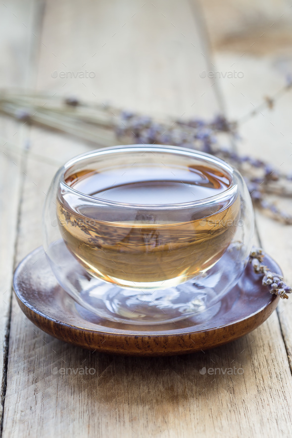 Healthy herbal lavender tea in oriental glass cup with lavender flowers on background, vertical - Stock Photo - Images