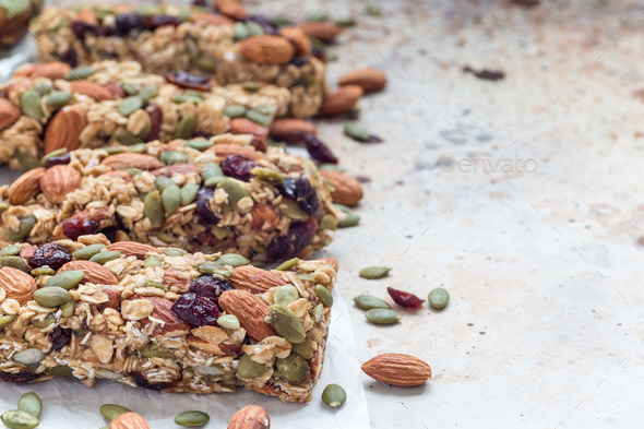 Homemade granola energy bars with figs, oatmeal, almond, dry cranberry and pumpkin seeds - Stock Photo - Images