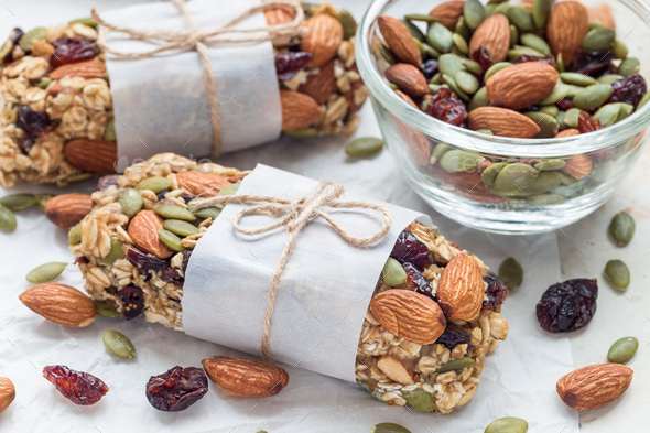 Granola energy bars with figs, oatmeal, almond, dry cranberry and pumpkin seeds - Stock Photo - Images