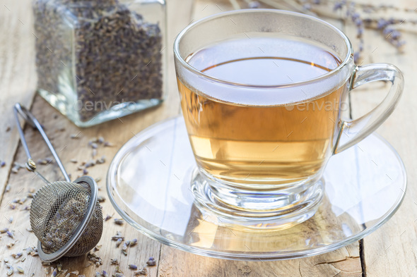 Healthy herbal lavender tea in glass cup with lavender flowers on background, horizontal - Stock Photo - Images