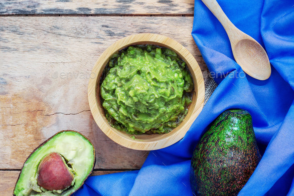 Avocado in bowl and tablecloth - Stock Photo - Images