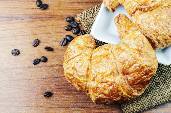 Croissant on on wooden floor - Stock Photo - Images