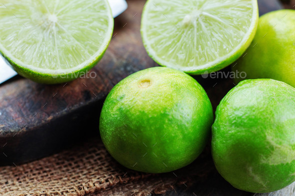 Green lime on wooden - Stock Photo - Images
