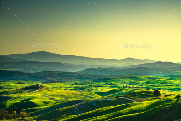 Volterra panorama, rolling hills, trees and green fields at suns - Stock Photo - Images