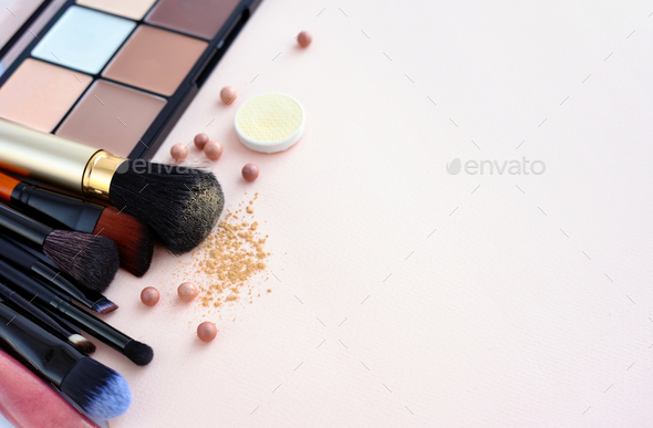 Makeup brush and decorative cosmetics on a pastel pink backgroun - Stock Photo - Images
