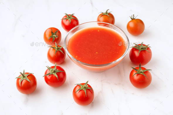 tomatoes and tomato sauce on elegant marble - Stock Photo - Images