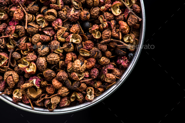 Sichuan pepper on pot on dark background - Stock Photo - Images