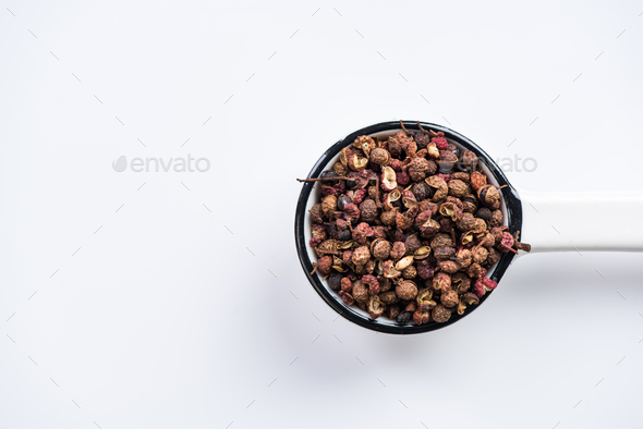 Sichuan pepper or Chinese coriander on spoon - Stock Photo - Images