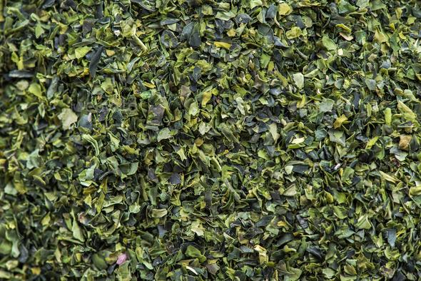 Detail macro of Aonori dried seaweed flakes - Stock Photo - Images