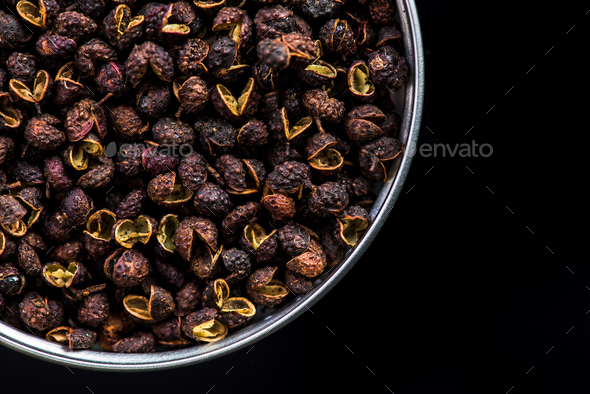 Pot with Timut Nepalese pepper on dark - Stock Photo - Images