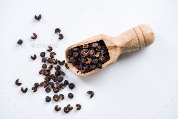 wooden spoon with Tibetan Timut Pepper - Stock Photo - Images