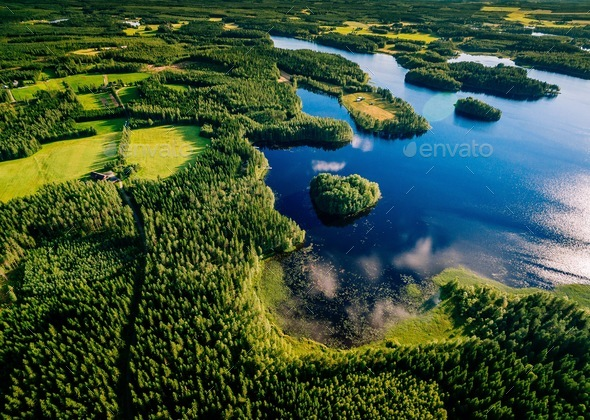 Aerial view of blue lakes and green forests on a sunny summer day in Finland. - Stock Photo - Images