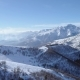 Backward Aerial on White Snow Mountain Peak in Winter - VideoHive Item for Sale