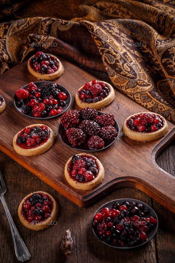 Delicious berry fruits mini tarts - Stock Photo - Images