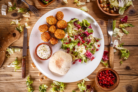 Falafel, deep fried balls of ground chickpeas - Stock Photo - Images