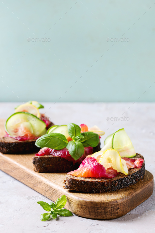 Beetroot marinated salmon sandwiches - Stock Photo - Images
