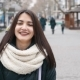A Laughing Girl Strolls in a City Street and Looks Sweet in Winter in Slo-mo - VideoHive Item for Sale