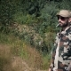 Brutal Bearded Soldier in Sunglasses Smoking Cigarette in Forest Background - VideoHive Item for Sale