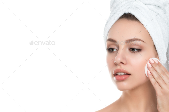 Portrait of young beautiful woman cleaning her face - Stock Photo - Images