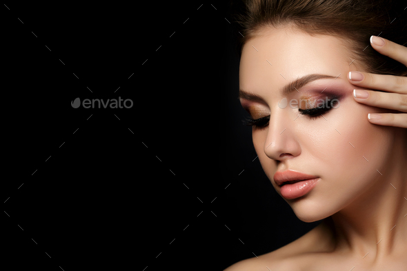 Portrait of young beautiful woman with evening make up - Stock Photo - Images