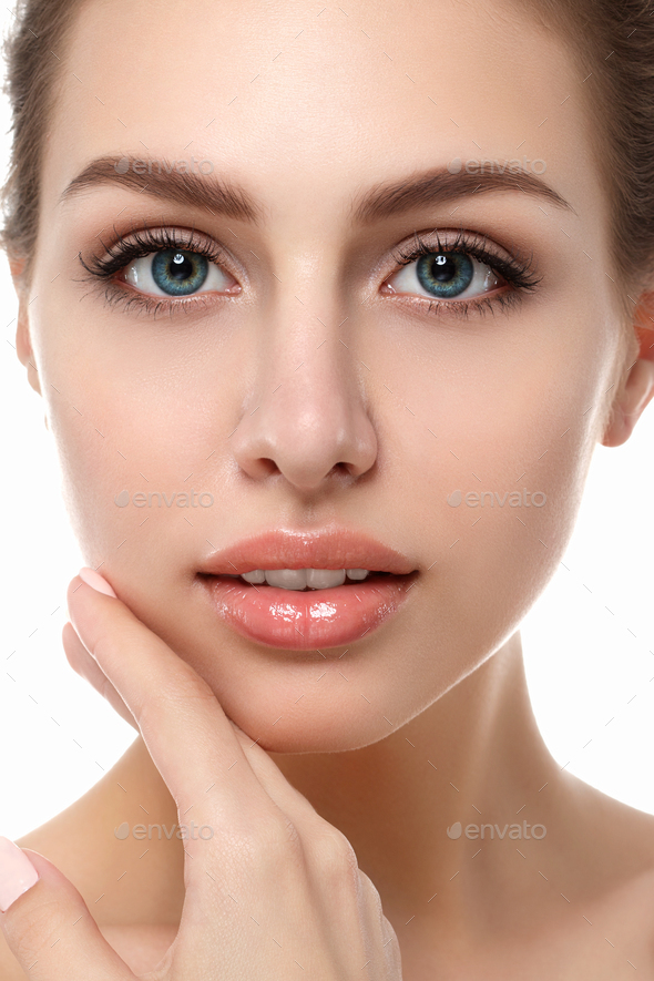 Portrait of young beautiful woman touching her face - Stock Photo - Images