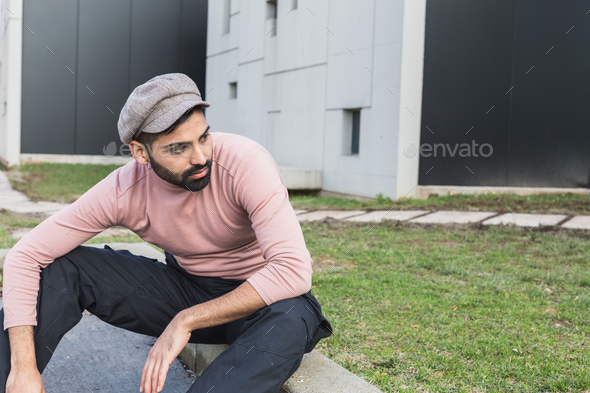 Young Indian man posing in an urban context - Stock Photo - Images