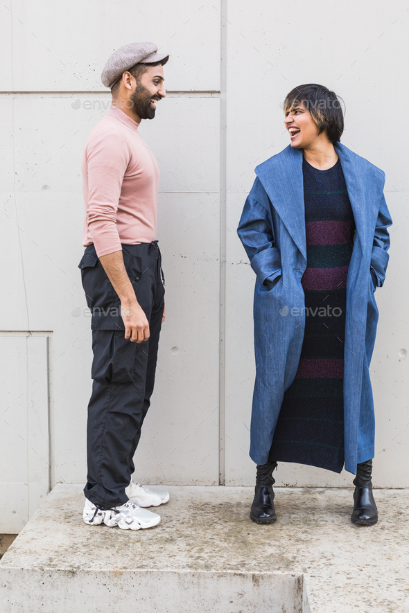 Indian couple posing in an urban context - Stock Photo - Images