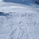 Skier Alpine Skiing with Dog Running Behind in Winter Snowy Mountain Ski Track - VideoHive Item for Sale