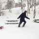 Father Pulling Red Bobsled on Snowy Field with child.Dad, Son or Daughter - VideoHive Item for Sale