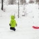 Winter Side Follow Little Child Pulling Red Bobsled - VideoHive Item for Sale