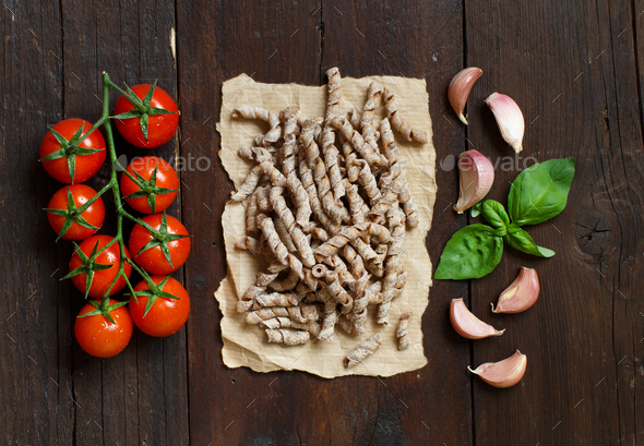 Whole wheat pasta, tomatoes, basil and garlic - Stock Photo - Images