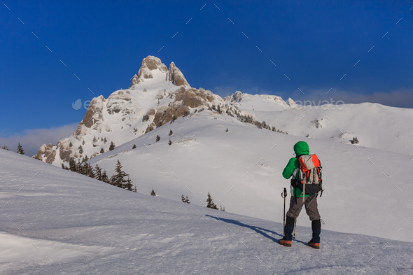climbing on mountain in winter - Stock Photo - Images