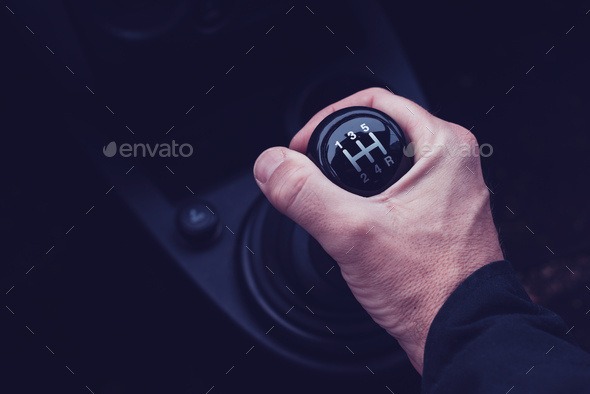 Male hand changing gear in the car - Stock Photo - Images
