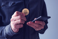 Man with bitcoin and mobile phone - PhotoDune Item for Sale