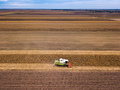 Aerial view of combine harvesting corn field - PhotoDune Item for Sale