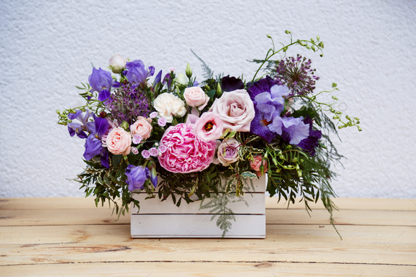 Beautiful tender bouquet of peonies in wooden box on rustic table - Stock Photo - Images