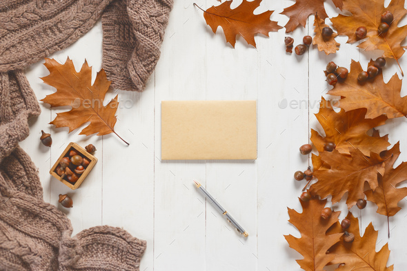 Unsigned envelope and pen on white wooden table with autumn accessories. View from above - Stock Photo - Images