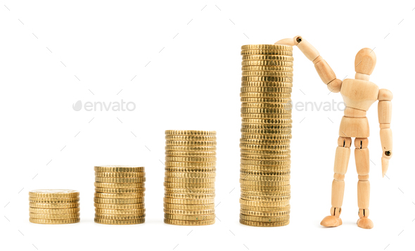 Graph from gold coins with wooden model - Stock Photo - Images