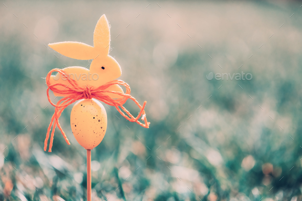 Easter background concept with yellow bunny figure - Stock Photo - Images
