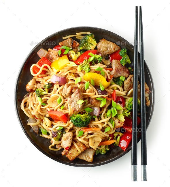 Plate of noodles with meat and vegetables - Stock Photo - Images