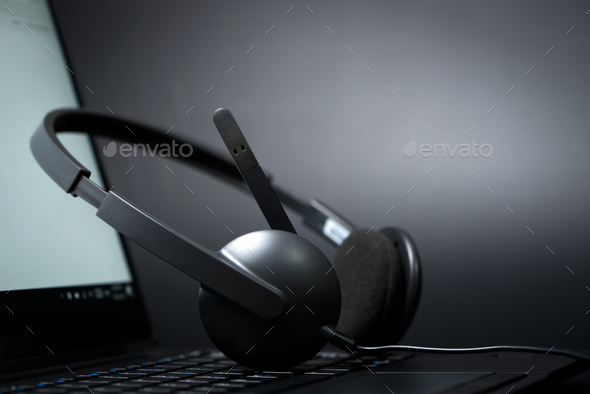Headset on a laptop computer - Stock Photo - Images
