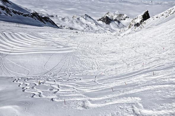 Ski resort in the Alps. Ski slopes, piste, powder snow in the mountains - Stock Photo - Images
