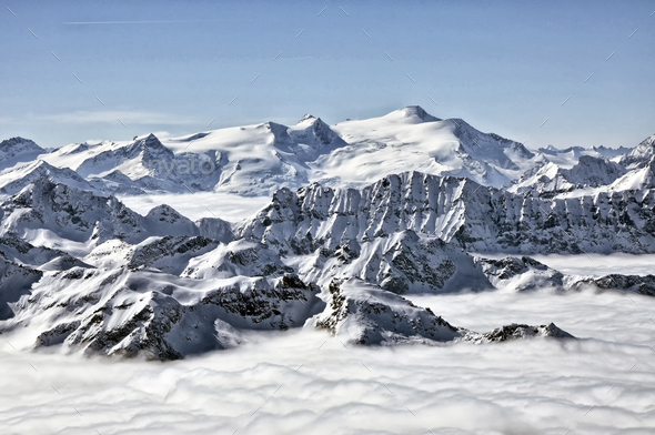 Snowcapped mountain peaks in the Alps.  - Stock Photo - Images