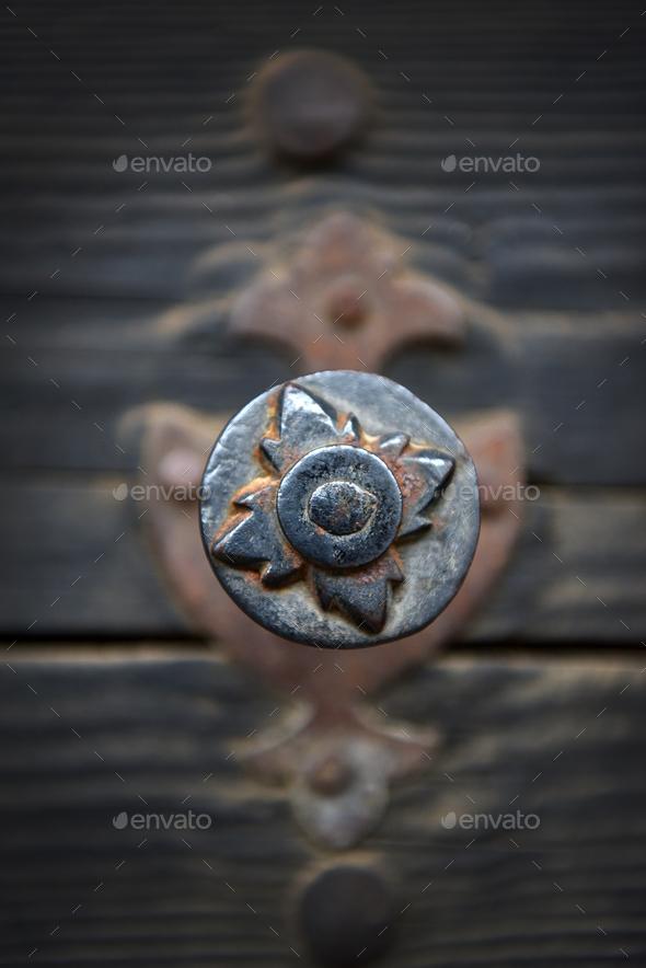 Rusty iron door knob on a vintage wooden door - Stock Photo - Images