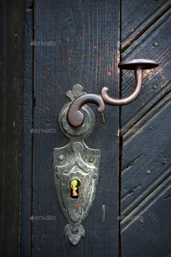 Vintage door handle on a wooden door - Stock Photo - Images