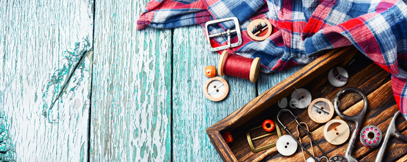 Sewing buttons and spools of thread - Stock Photo - Images