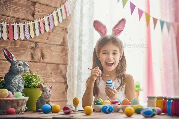 child painting eggs - Stock Photo - Images
