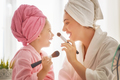 Mother and daughter are doing make up - PhotoDune Item for Sale
